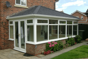 Edwardian conservatory with black tiled roof