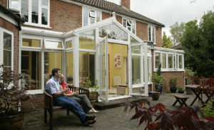 White uPVC T shaped conservatory exterior